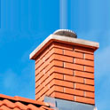 brick chimney with smoke coming from the top