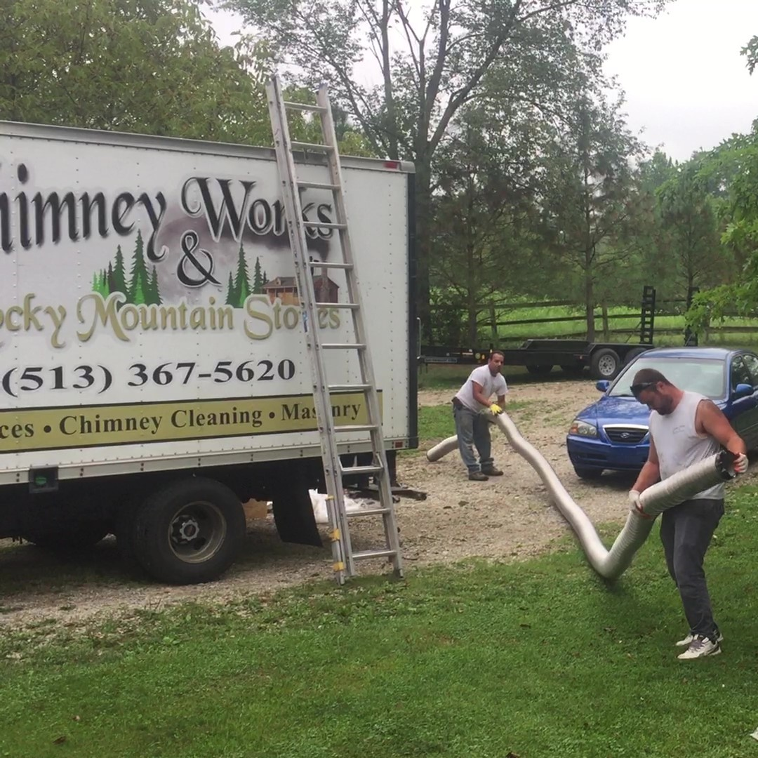 Chimney Sweeps prepare for a liner install.