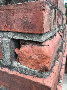 Busted Brick In A Chimney