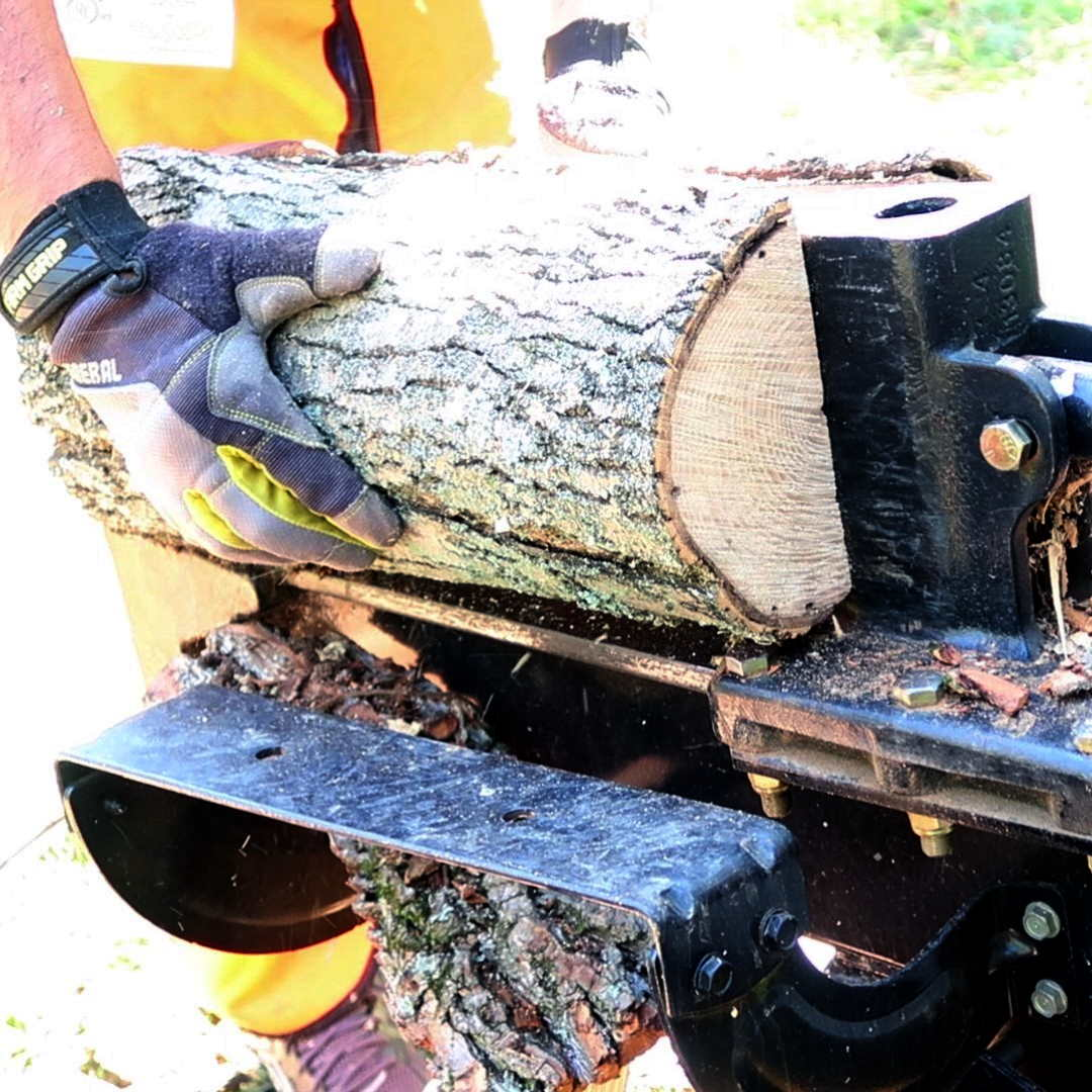 firewood being split with a log splitter