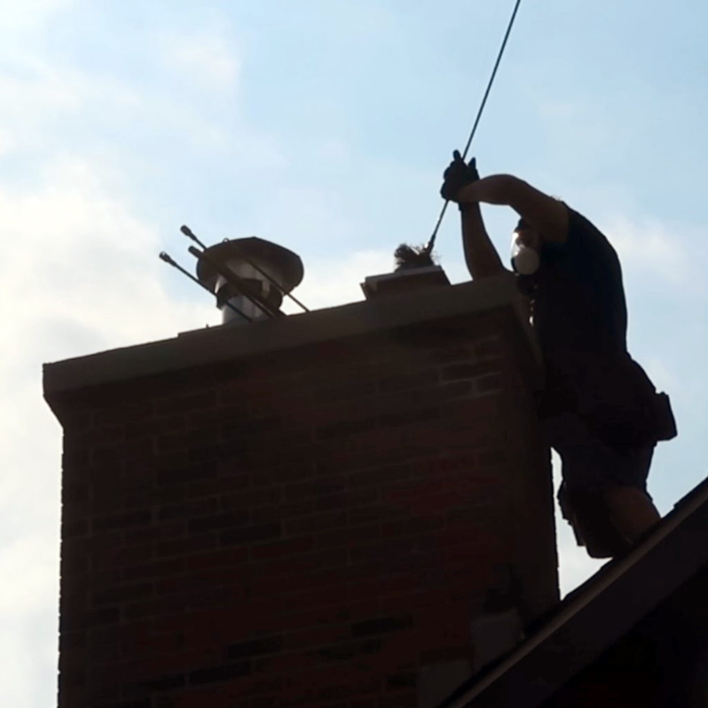 A Chimney Sweep cleans a chimney.