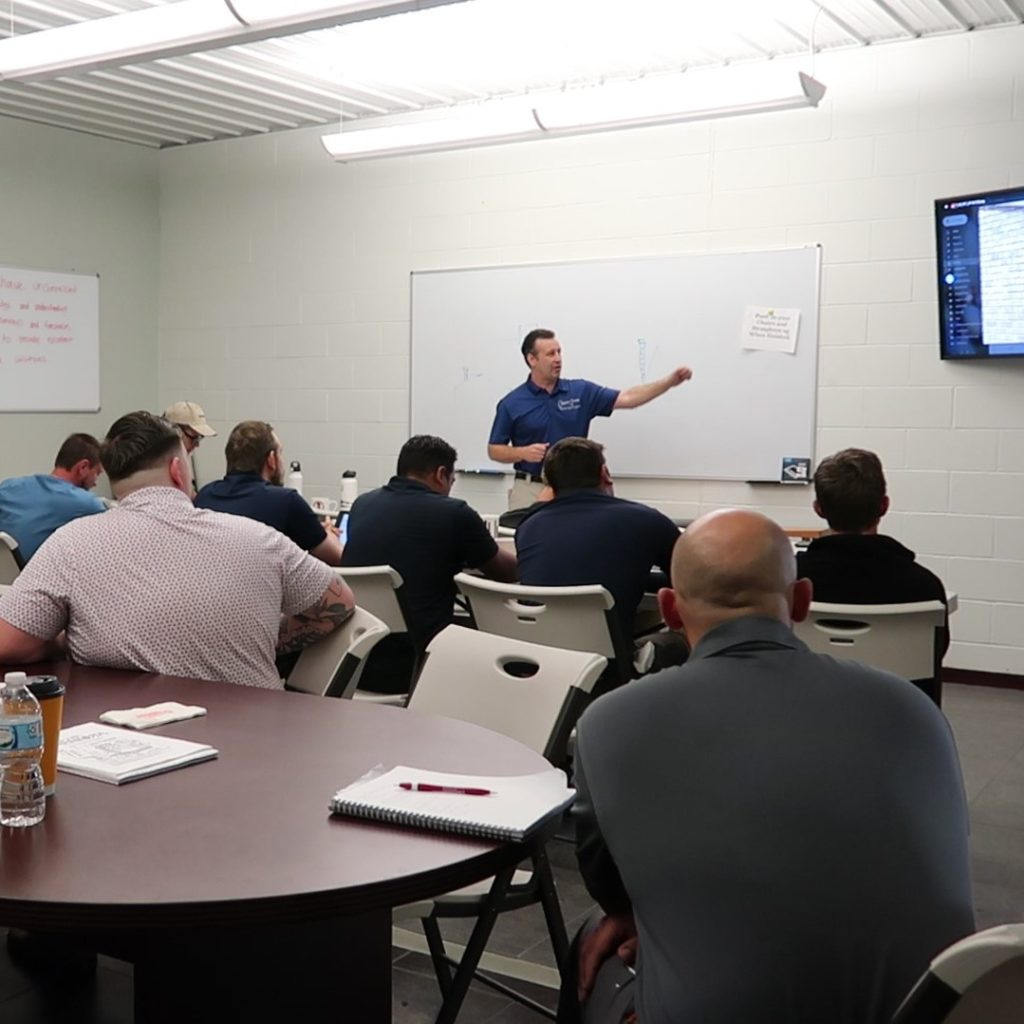 A Chimney Works Employee leads a training class.