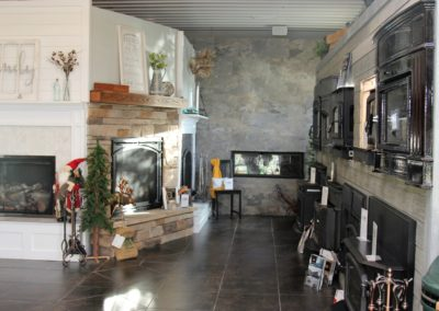 Fireplace showroom with decorated mantles and hearths.