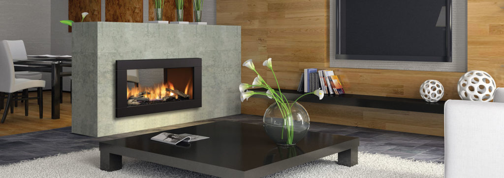 A see through fireplace in a living room area.