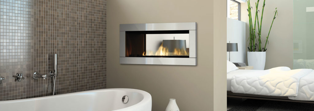 A see through fireplace in a bathroom area.