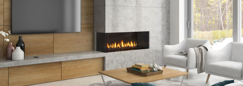 A corner fireplace in a living room area.