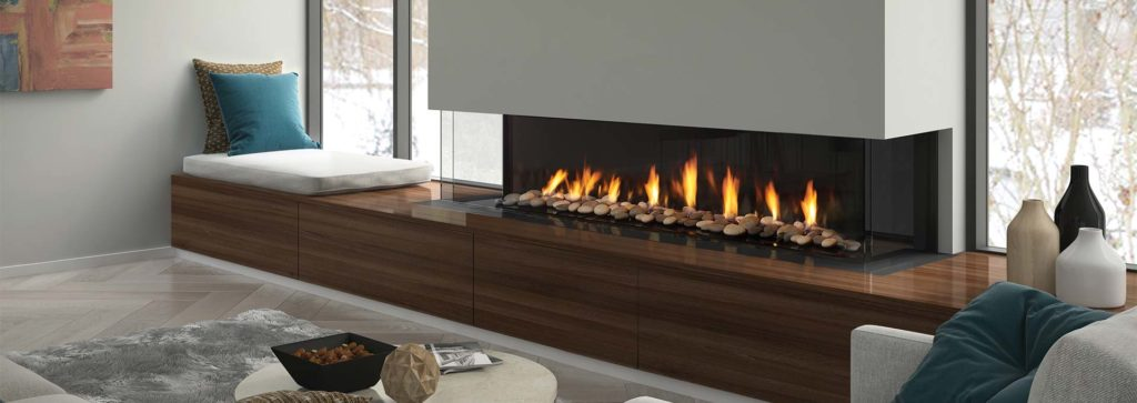 A three sided fireplace in a modern living space with inbuilt storage beneath.