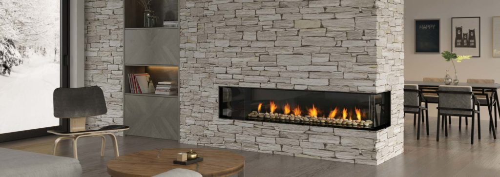 A corner fireplace in a modern living space with a stone veneer wall.